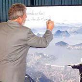Lula assina o pôster do Rio de Janeiro